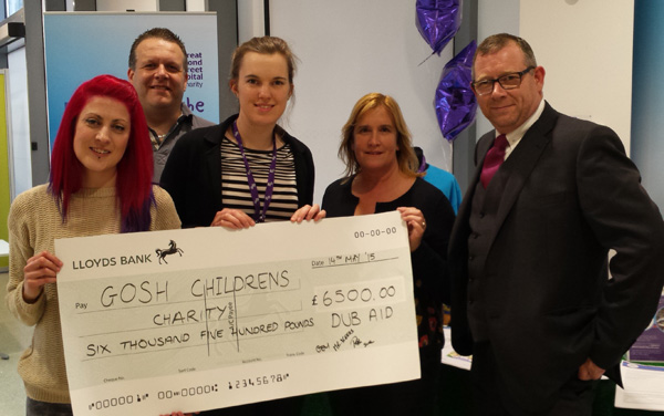 Presenting cheque for £6,500 to Gt Ormond Str Hospital